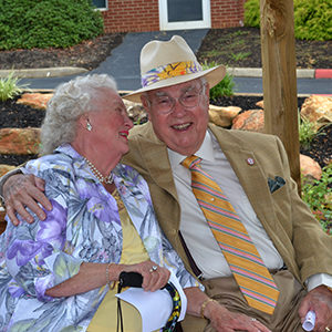 Dr. Joe Frank Hayes Sr. and wife smiling.